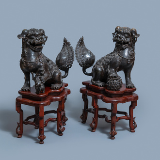 A pair of large Chinese bronze models of Buddhist lions, Ming