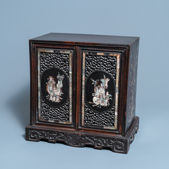 A Chinese or Vietnamese mother-of-pearl-inlaid wooden two-door cabinet, 19th C.