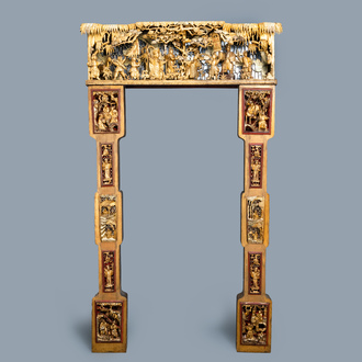 A Chinese gilded wood carving on matching pillars, 19th C.