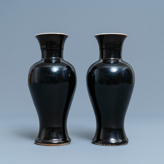 A pair of Chinese monochrome mirror black vases, 19th C.
