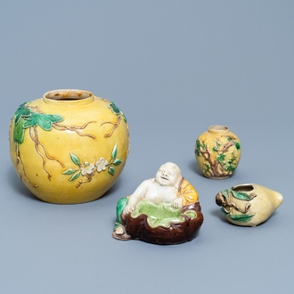 Two Chinese yellow and verte biscuit jars, a Buddha figure and a peach-shaped brush washer, 19/20th C.