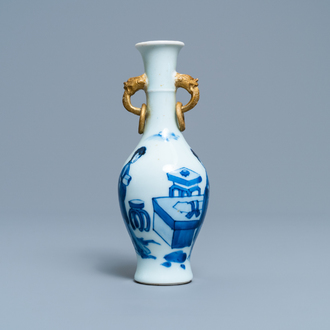 A Chinese blue and white vase with gilt elephant-head handles, Kangxi