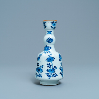A Chinese blue and white elongated huqqa base with floral design, Kangxi