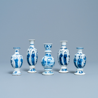 Four Chinese blue and white miniature vases and a huqqa base, Kangxi