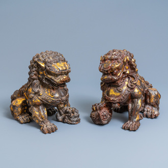 A pair of large Chinese gilt-lacquered iron models of Buddhist lions, 18/19th C.