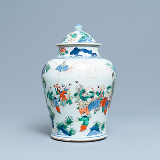 A Chinese wucai 'playing boys' vase and cover, Transitional period