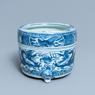 A Chinese blue and white 'dragon' tripod censer, Ming