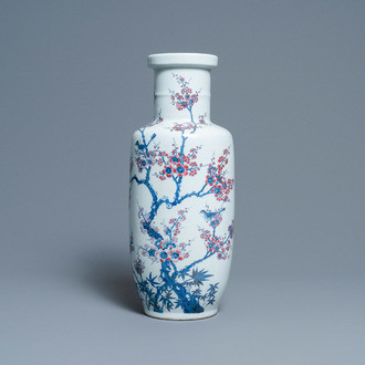 A Chinese blue, white and copper-red rouleau vase with birds among blossoming branches, 20th C.