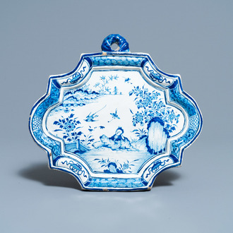 A Dutch Delft blue and white chinoiserie plaque, 18th C.