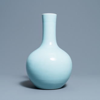 A Chinese monochrome clair de lune bottle vase with an incised design, 19/20th C.