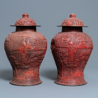 A pair of Chinese red cinnabar lacquer vases and covers, Zhengde mark, Qing