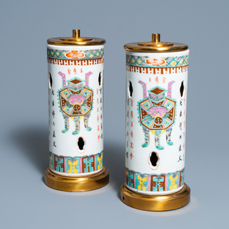 A pair of Chinese reticulated famille rose hat stands mounted as lamps, 19th C.
