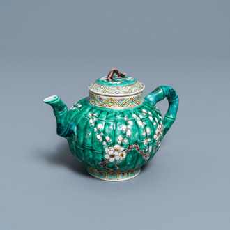 A Chinese verte biscuit teapot and cover, Kangxi