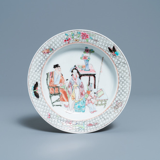 A Chinese famille rose plate with figures in an interior, Yongzheng