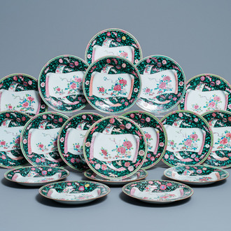 Eighteen Chinese famille rose plates with floral sprigs on scrolls, Yongzheng