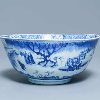 A large Chinese blue and white bowl with figures in a landscape, Kangxi