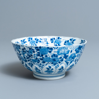 A Chinese blue and white floral bowl, Kangxi mark and of the period