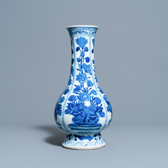 A Chinese blue and white bottle vase with flower arrangements, Kangxi