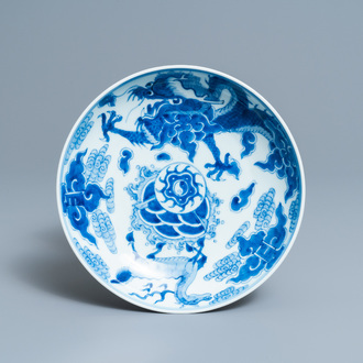 A Chinese blue and white 'dragon and qilin' dish, Yongzheng mark and of the period