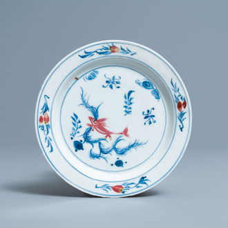 A Chinese blue, white and copper-red 'fish' plate, Wanli