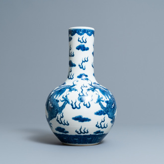 A Chinese blue and white 'dragons' bottle vase, Yongzheng mark, 19th C.