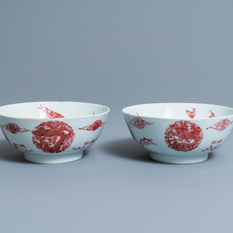 A pair of Chinese copper-red 'dragons and carps' bowls, Kangxi/Qianlong