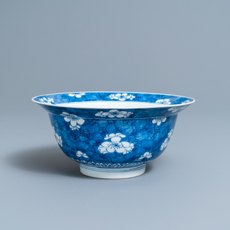 A Chinese blue and white 'prunus on cracked ice' bowl, Kangxi