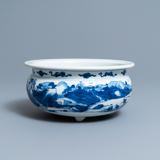A Chinese blue and white tripod censer with figures in a mountainous river landscape, Kangxi