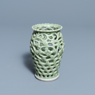 A Chinese reticulated monochrome Longquan celadon brush pot, Ming