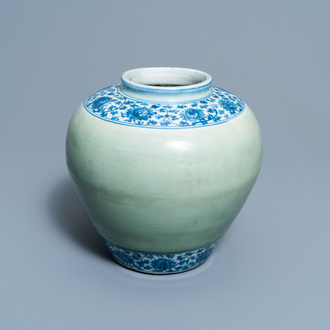 A Chinese celadon-ground and blue and white 'lotus scroll' jar, Ming