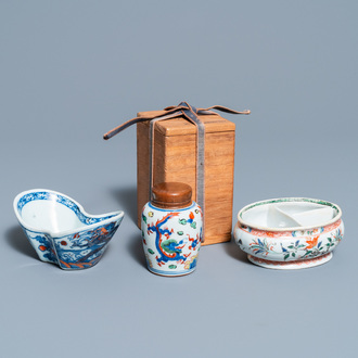 A Chinese doucai bowl, a famille verte spice box and a wucai tea caddy, Kangxi and later