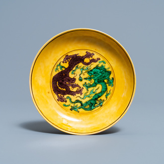 A Chinese yellow-ground green and aubergine 'dragon' dish, Kangxi mark and of the period