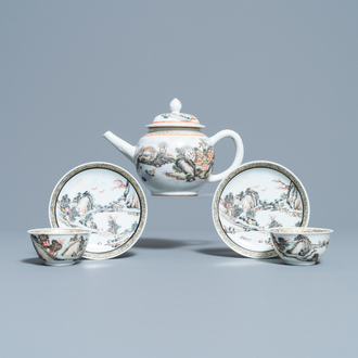 A fine Chinese 'landscape' teapot and a pair of cups and saucers, Yongzheng