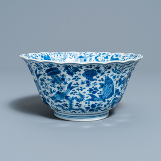 A Chinese blue and white lobed 'carps and crab' bowl, Kangxi