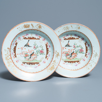 A pair of Chinese famille rose plates with birds among blossoming branches, Yongzheng/Qianlong