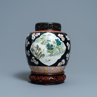 A Chinese black-ground famille rose jar, 19th C.