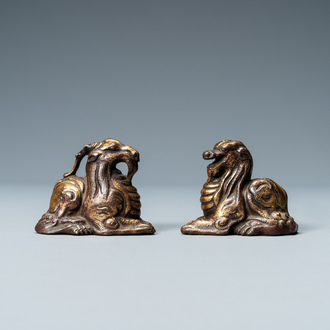 Two Chinese gilt and lacquered bronze 'mythical beast' scroll weights, late Ming