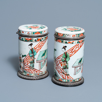 A pair of Chinese silver-mounted cylindrical famille verte covered jars, Kangxi