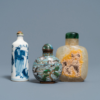 Three Chinese chalcedony, cloisonné and porcelain snuff bottles, 19th C.