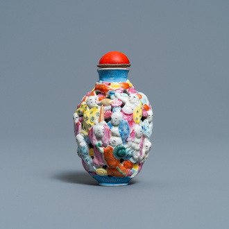 A Chinese famille rose molded, reticulated and double-walled '18 Luohans' snuff bottle, Qianlong mark, 19th C.