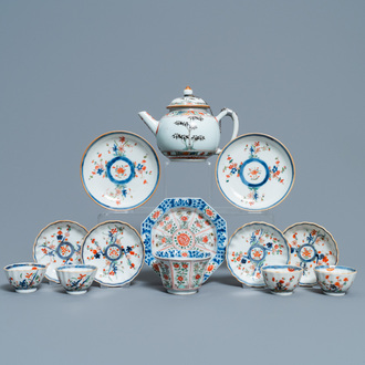 A Chinese famille verte teapot, seven saucers and five cups, Kangxi