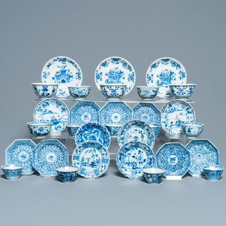 Sixteen Chinese blue and white saucers and fourteen cups, Kangxi
