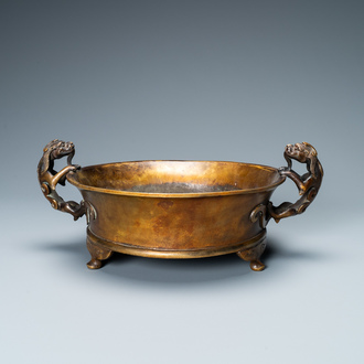 A large Chinese bronze tripod censer with chilong handles, Xuande mark, 18/19th C.
