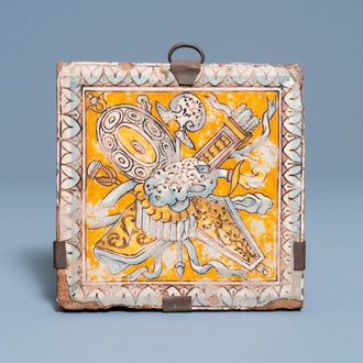 A maiolica floor tile with weapons and armoury, Italy or France, 16/17th C.