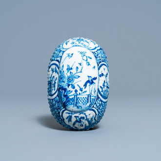 A ribbed Dutch Delft blue and white chinoiserie brush back, 18th C.
