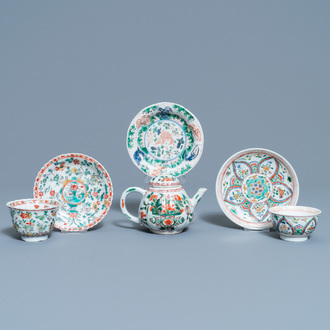 A Chinese famille verte teapot, two cups and three saucers, Kangxi