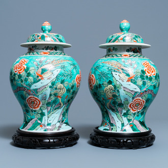 A pair of Chinese turquoise-ground famille verte vases and covers, 19th C.