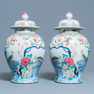 A pair of Chinese famille rose 'pheasants' vases and covers, 19th C.