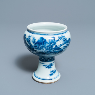 A Chinese blue and white stem cup with a continuous landscape scene, Kangxi/Yongzheng