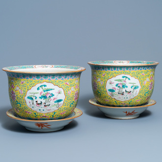 A pair of Chinese famille rose jardinières on stands, 19th C.
